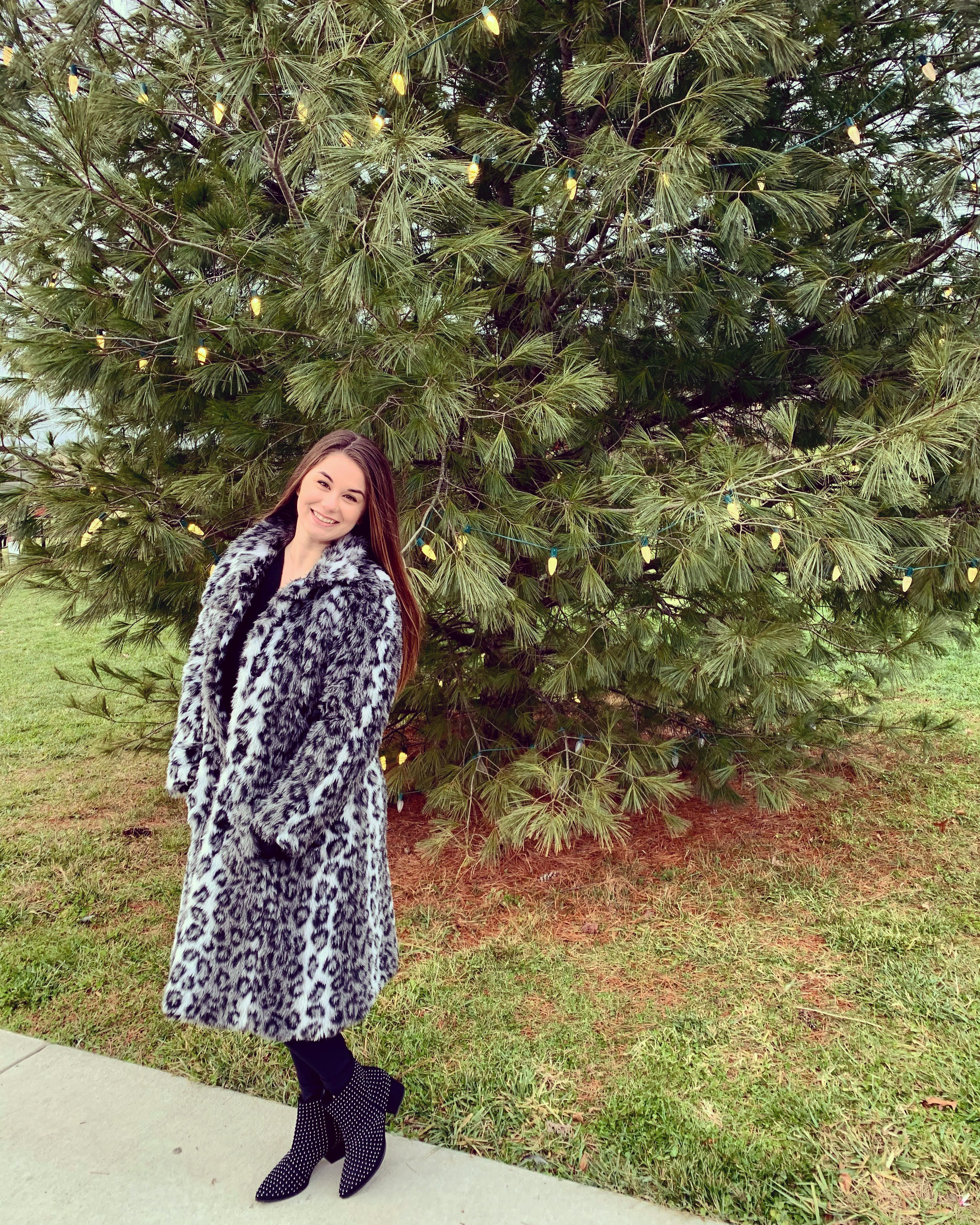 Lindsey Germann standing in front of a tree