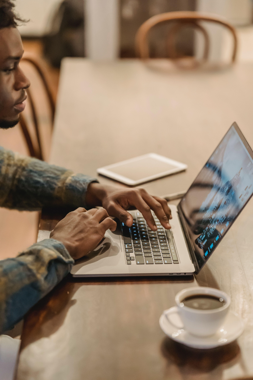 man browsing website on laptop