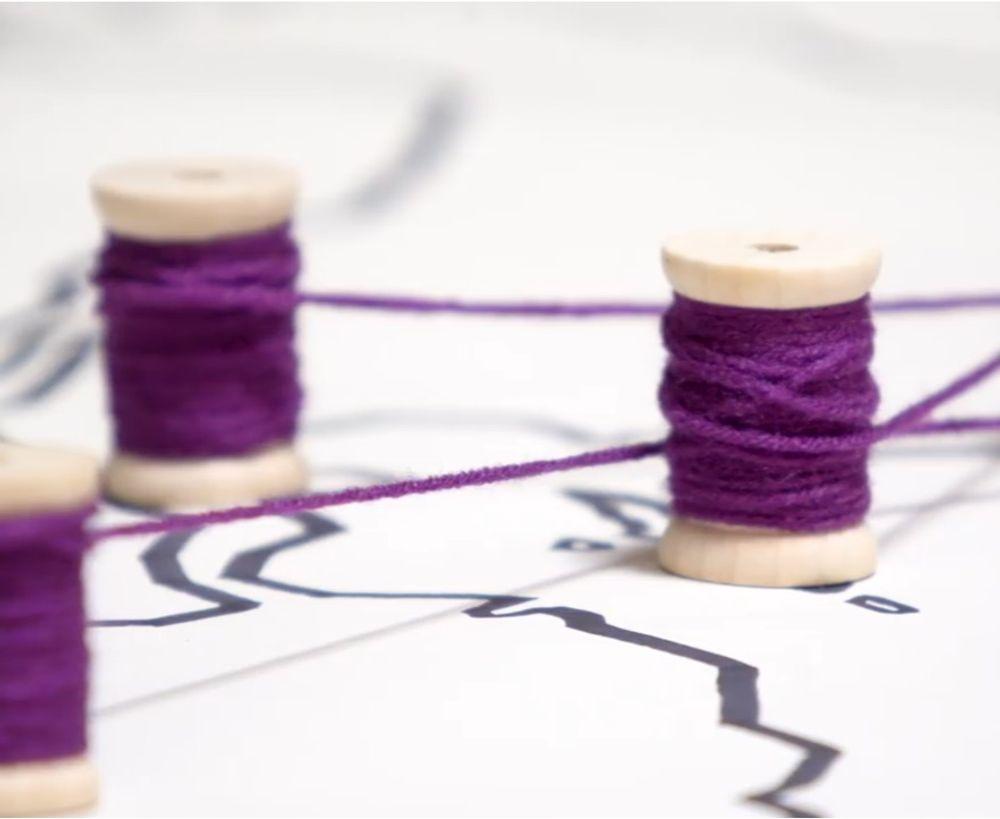 Spools of purple thread